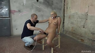 Blonde slave girl endures rough treat from her male