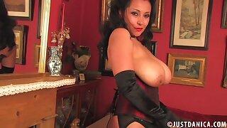 Curvy mature Danica Collins drops her black panties to play