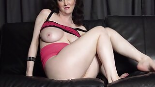 Sexy MILF with buxom body bangs herself with fingers on the sofa