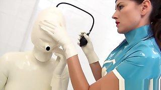 Lesbian nurse in latex catsuit